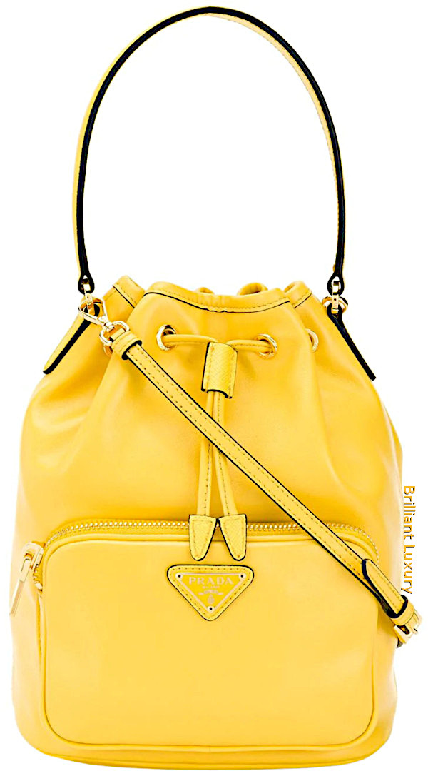 Prada logo plaque bucket bag in Pantone color aspen gold
