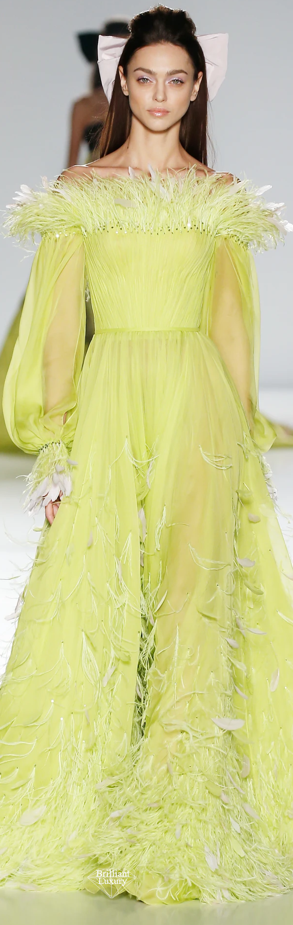 Ralph & Russo chartreuse silk chiffon bell sleeve gown featuring hand pleated details enriched with crystals sequins coque and ostrich feathers in chartreuse and pale pink #brilliantluxury