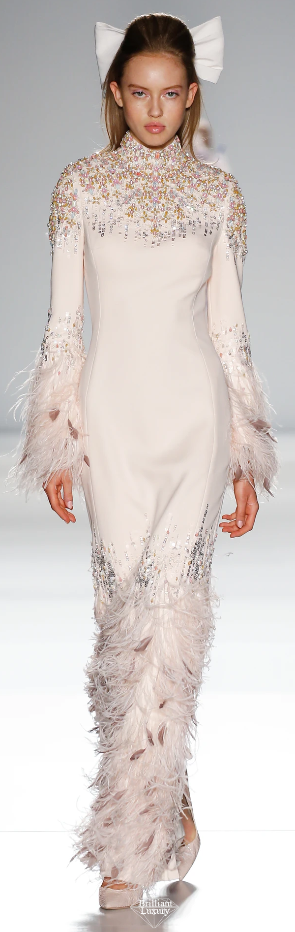 Ralph & Russo pale peach silk crêpe cady column gown featuring long bell sleeves and adorned with sequins xilions crystals ostrich and coque feathers #brilliantluxury